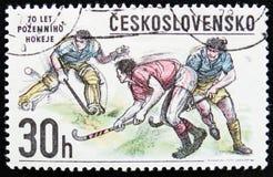 Перебрасывайтесь хоккеисты, спорт зимы, около 1978 Стоковые Фото
