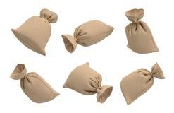 перевод 3d нескольких гессенских сумок денег, заполненный и закрытый с веревочкой, летая на белую предпосылку стоковые фотографии rf