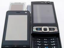 передвижное самомоднейшее pda знонит по телефону куче нескольк стога стоковая фотография