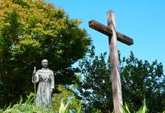 перекрестная статуя священника Стоковые Фотографии RF