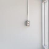 Переключите свет на белой стене Стоковое Изображение RF