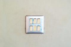 Переключите свет на стене с мягким светом Стоковое Изображение RF