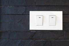 Переключите свет на черной каменной стене Стоковое Изображение RF