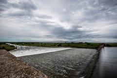 Переполняя водосброс Стоковое Изображение