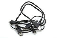 3 переплетаннсяых Isolaed кабеля USB на белизне Стоковые Фотографии RF