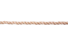 Переплетенная веревочка Манилы изолированная на белизне Стоковые Изображения