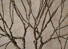 Переплетенный провод формируя дерево с текстурированной предпосылкой Стоковая Фотография RF