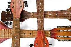 Пересеченные fingerboards 4 старых мандолин Изолировано на белизне стоковые фотографии rf