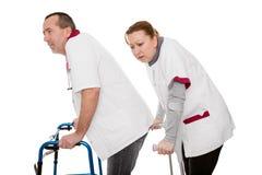 2 пересматриванных медсестры хромают Стоковое фото RF