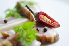 Перец красных чилей на беконе Стоковая Фотография