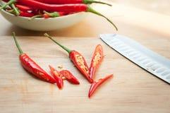 Перец Chili на разделочной доске Стоковое Фото