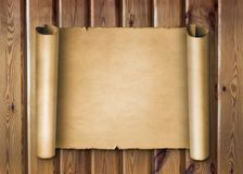 Перечень пергамента на деревянной предпосылке Стоковые Изображения RF