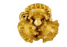 Передний зуб бита утеса золотого цвета tricone сверля стоковое изображение rf