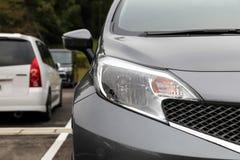 Передний свет современного автомобиля спорт Стоковые Фотографии RF