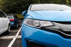 Передний свет современного автомобиля спорт Стоковая Фотография