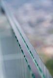 Перила защитного стекла с предпосылкой нерезкости Стоковые Фото