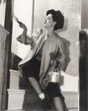 Перила картины женщины на лестнице Стоковые Изображения RF