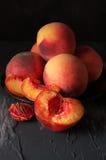 Персики на черноте Стоковое фото RF