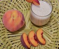 Персик и smoothie Стоковое фото RF