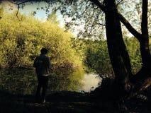Персона берега озера Стоковая Фотография RF