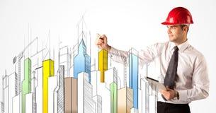 Персона дела делая эскиз к визированию города Стоковое фото RF