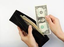 Персона принимая деньги от бумажника Стоковое Изображение RF