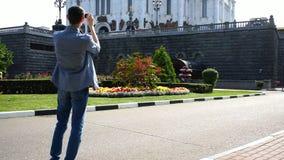 Персона фотографирует визирования на smartphone сток-видео
