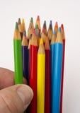 Перста касатьются карандашу зеленого цвета от группы Стоковая Фотография RF