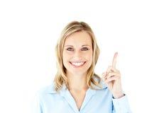 перст коммерсантки указывая усмехаться вверх Стоковые Изображения RF