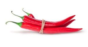 3 перца красных chili связанного с веревочкой Стоковые Фото