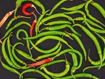 Перцы зеленого и красного chili на черноте Стоковое фото RF