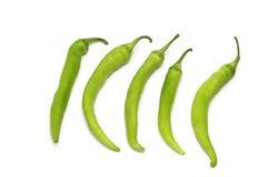перцы изолированные зеленым цветом стоковое фото rf