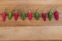Перцы Chili все в ряд Стоковая Фотография