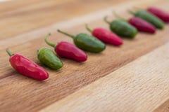 Перцы Chili все в ряд Стоковые Изображения