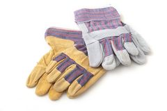 Перчатки безопасности на белой предпосылке Защитные перчатки работника Стоковое фото RF