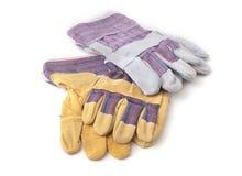 Перчатки безопасности на белой предпосылке Защитные перчатки работника Стоковые Фотографии RF