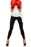 Перчатки бокса женщины нося Стоковые Изображения