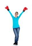 Перчатки бокса привлекательной молодой женщины нося Стоковая Фотография