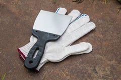 Перчатки и шпатель Стоковое Фото