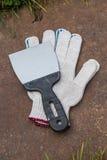 Перчатки и шпатель Стоковое фото RF