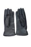 Перчатки красивых черных кожаных женщин изолированные на белизне. Стоковые Изображения RF