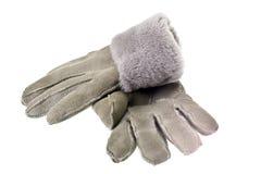 Перчатки меха зимы женщин на белой предпосылке Стоковая Фотография