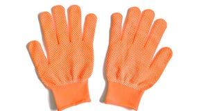 Перчатки работы оранжевые на белой предпосылке стоковые изображения