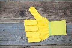 Перчатки с поднятым большим пальцем руки вверх Стоковая Фотография
