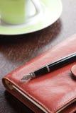 пер кружки дневника кофе Стоковые Изображения