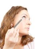 пер mascara девушки кладет Стоковое Изображение RF