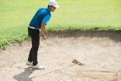 Песок вешалки игрока в гольф на поле для гольфа, Таиланде Стоковое Изображение