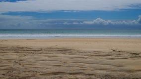 Песок, вода и облака Стоковая Фотография