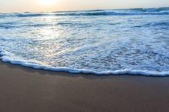 Песок воды мытья пляжа Стоковое Изображение