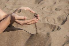 Песок в руках Стоковые Фото